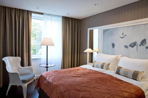 A bed or beds in a room at The Harmonie Vienna, BW Premier Collection