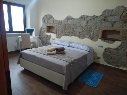 A bed or beds in a room at b&b il Portico Orgosolo