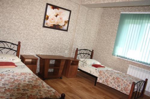 Кровать или кровати в номере Мини-отель Камилла