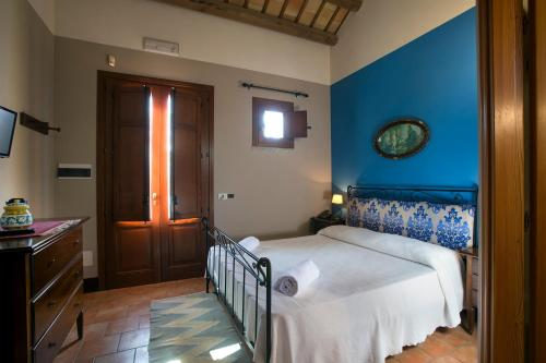 A bed or beds in a room at Agriturismo Don Carlo