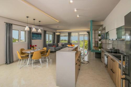 A kitchen or kitchenette at Evgenia Apartment