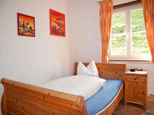 Ein Bett oder Betten in einem Zimmer der Unterkunft Vogtadeshof