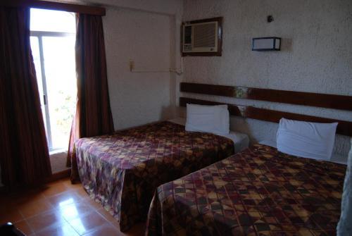 Cama o camas de una habitación en Hotel Tankah Cancun