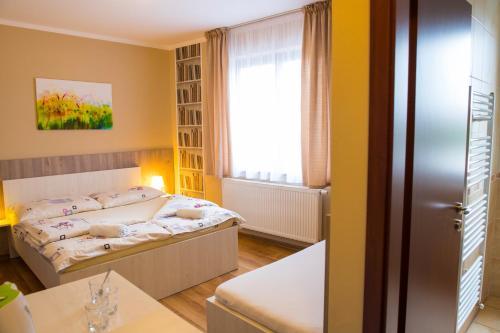 Posteľ alebo postele v izbe v ubytovaní Penzión Stefarez New