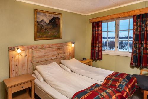 En eller flere senger på et rom på Venabu Fjellhotell