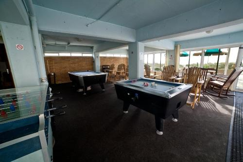 A pool table at DeSoto Beach Hotel