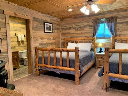 A bunk bed or bunk beds in a room at Yellowstone Cutthroat Guest Ranch