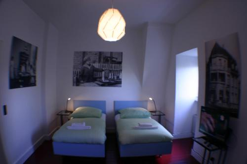 A bed or beds in a room at Central Pension