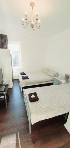 A bed or beds in a room at Regent Guest House