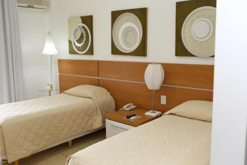 A bed or beds in a room at Elsenau Hotel