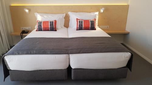 Uma cama ou camas num quarto em Hospedaria Frangaria