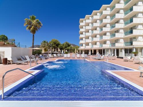 The swimming pool at or near Boutique Hotel H10 Blue Mar - Adults Only