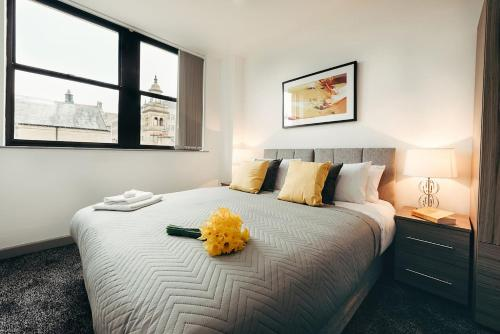 A bed or beds in a room at Halifax House, One Bedroom Apartment 216