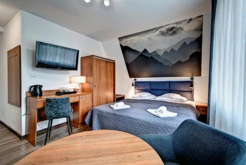 Łóżko lub łóżka w pokoju w obiekcie Willa Maura