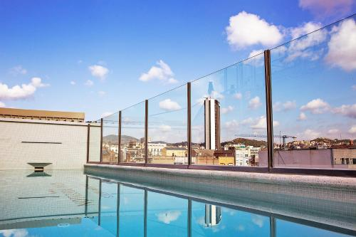 The swimming pool at or near Bcn Urbaness Hotels Gran Rosellon