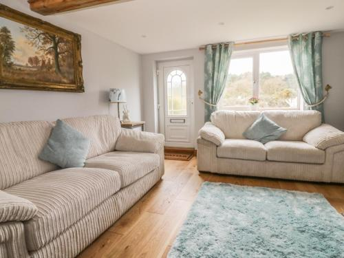 A seating area at 2 Hillside Cottages