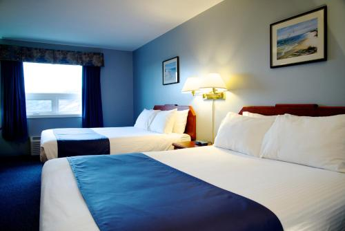 A bed or beds in a room at St Christopher's Hotel