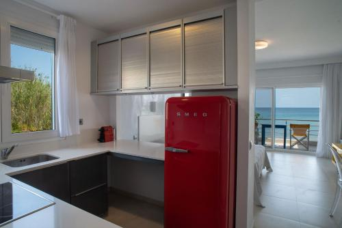 A kitchen or kitchenette at Sideratos Apartments
