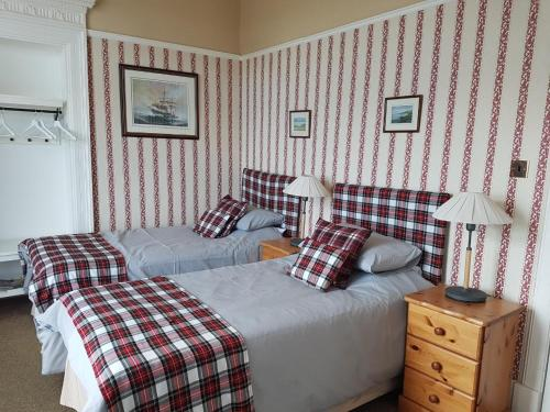 A bed or beds in a room at Seaview Guest House