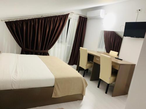 A bed or beds in a room at FAST Airport Hotel
