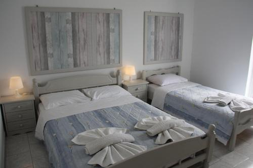 A bed or beds in a room at Kalypso Apartments