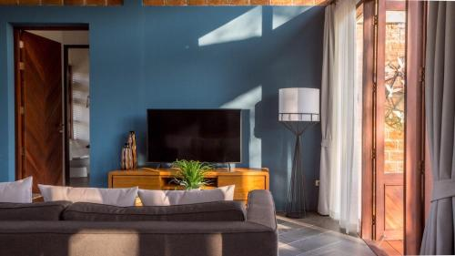 A television and/or entertainment center at 180 Sanctuary at Puripai Villa