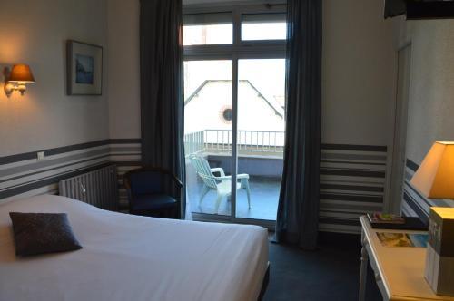 Un ou plusieurs lits dans un hébergement de l'établissement Hôtel des Druides
