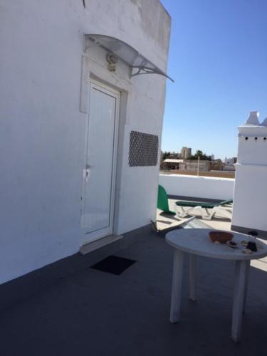A balcony or terrace at Casa Tradicional Algarvia - Rooms