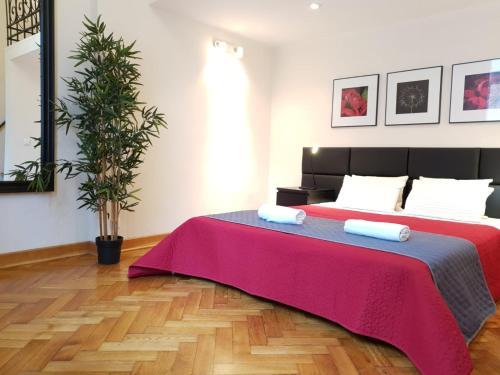 Łóżko lub łóżka w pokoju w obiekcie Aparthotel Old City
