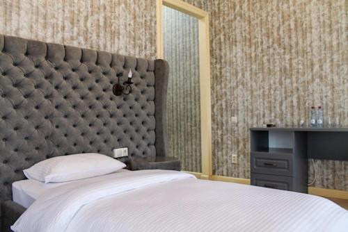 Кровать или кровати в номере Hotel DaLi