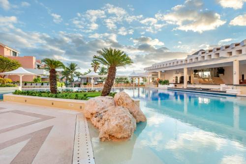 The swimming pool at or near Omni Cancun Hotel & Villas All Inclusive
