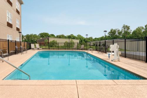The swimming pool at or near Country Inn & Suites by Radisson, Nashville Airport East, TN