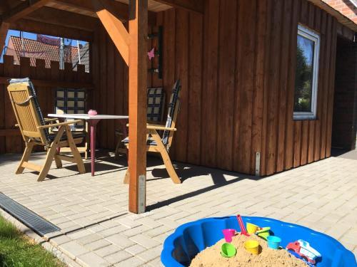 Ein Kinderspielbereich in der Unterkunft Ferienhaus Olenbrook