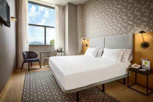 Cama o camas de una habitación en Hotel Sercotel Portales
