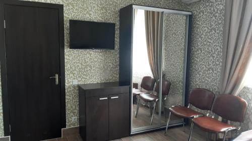 A television and/or entertainment center at Motel Xameleon