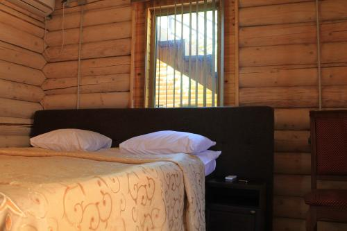 A bed or beds in a room at Chalet Rostov