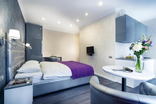 Ein Bett oder Betten in einem Zimmer der Unterkunft Flatlux Apartments