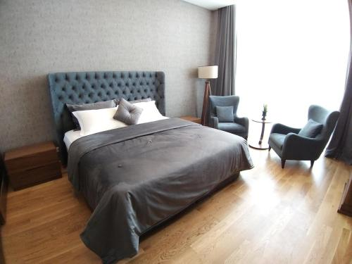 A bed or beds in a room at Teknosports Otel