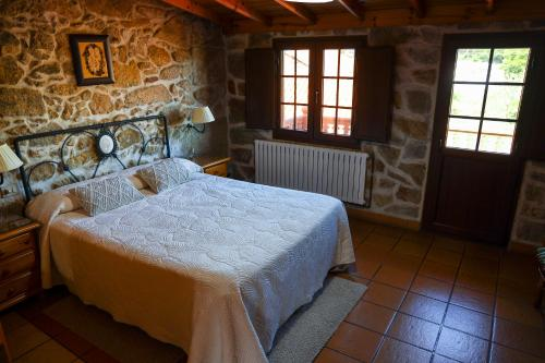 A bed or beds in a room at Casa Raúl