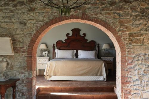 A bed or beds in a room at Castello di Casole, A Belmond Hotel, Tuscany