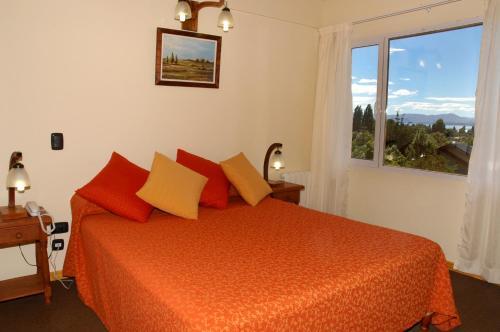 Una cama o camas en una habitación de Puente Austral