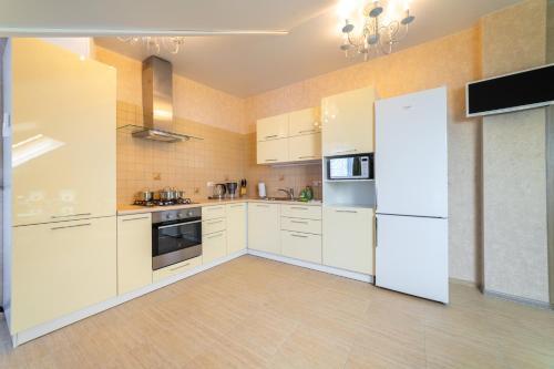 Кухня или мини-кухня в Апартамент на Станиславского