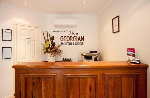 The lobby or reception area at Georgian Motor Lodge