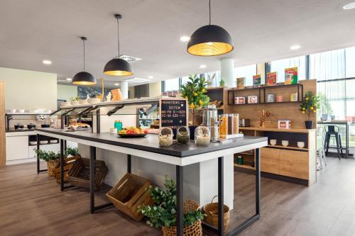 A restaurant or other place to eat at Super 8 by Wyndham Oberhausen am Centro