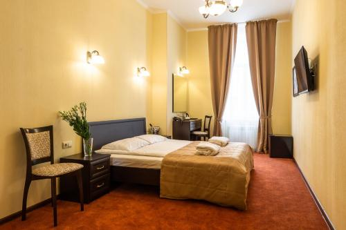 A bed or beds in a room at Solo na Bolshom Prospekte