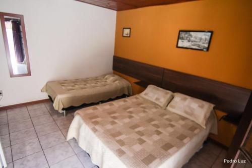 A bed or beds in a room at Hotel Halloween Inn Penedo