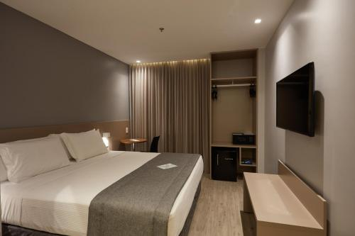 A bed or beds in a room at Flix Hotel