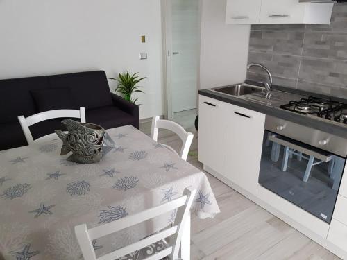A kitchen or kitchenette at Appartamenti Edia