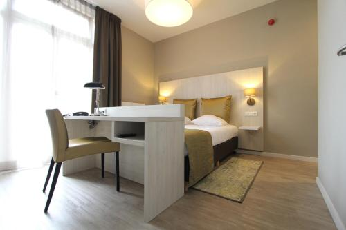 Ein Bett oder Betten in einem Zimmer der Unterkunft Apple Inn Hotel