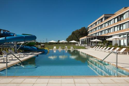 The swimming pool at or near Salinas del Almiron Resort Termal